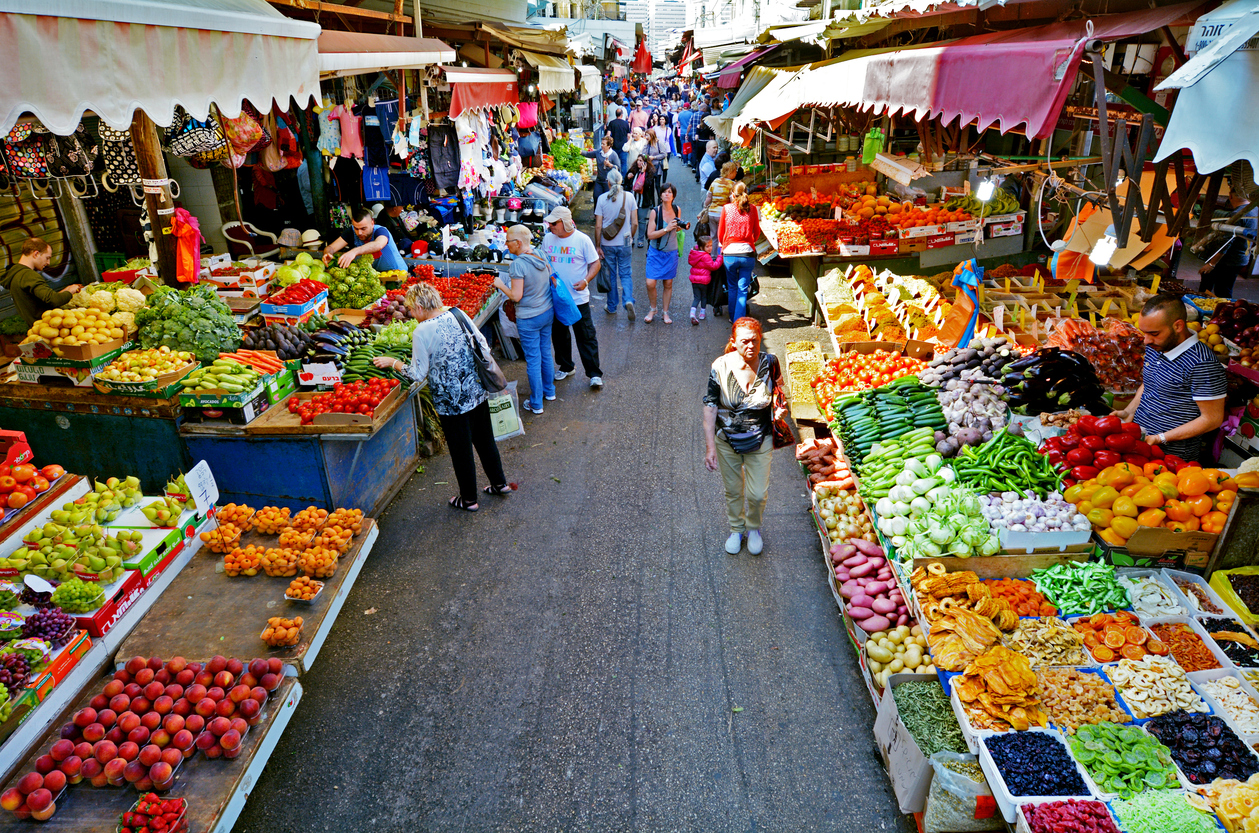 Tel Aviv, Israel - April 6, 2015: Shoppers at Carmel Market Shuk HaCarmel in Tel Aviv, Israel. Carmel market is a very popular marketplace in Tel Aviv sells mostly food and home accessories goods.